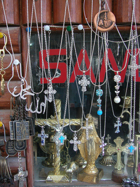 Christian and Islamic symbols at a souvenir shop in Maaloula, Syria